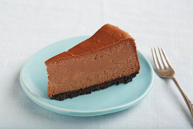 Melted chocolate in the batter and a chocolate wafer crust turn a classic New York cheesecake into a decadent dessert for chocolate lovers.