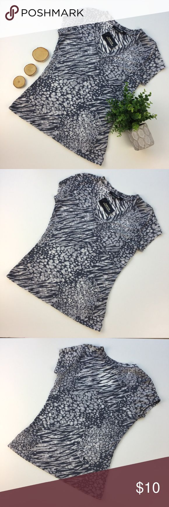 """Forever 21 Grey NWT Animal Print Short Sleeve M Forever 21 Grey & White Animal Print Short Sleeve 57% Polyester 43% Cotton NWT.   Super cute and comfy. Semi-sheer, Slubknit. Size M.  Underarm to underarm: 16""""   Length, shoulder seam to bottom hem: 23.5""""  Inventory: A2 Forever 21 Tops Tees - Short Sleeve"""