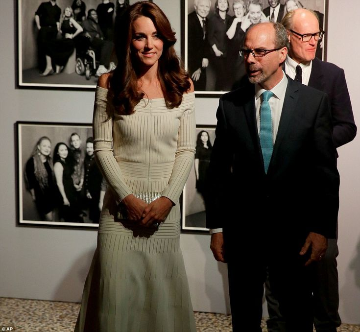 The Duchess of Cambridge walks with Stephen Deuchar the director of the Art Fund backdropped by Rankin photographs