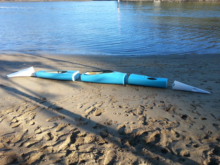 Sectional Kayak Switchblade 17ft in pieces. In a minute it will click together and be ready to launch.
