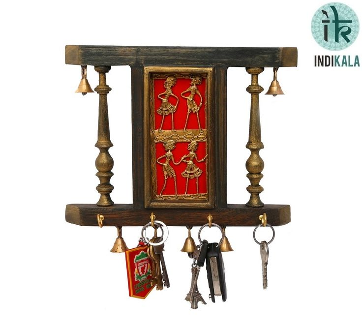 This ethnic key holder is made of wood.It is adorned with six bells.  The dhokra work brass plate is the middle adds sheen to this piece.   It can be used as a key ring holder as well as a decoration piece to beautify your house.