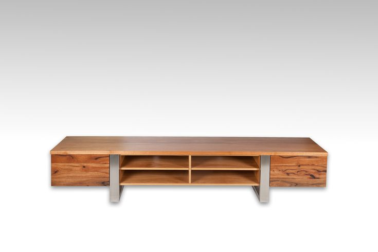 Cottesloe Lowline TV Unit. Handcrafted here in Fremantle using Timber sourced from around Australia. Using a combination of timber and stainless steel, our design team can custom make to you size and specified configuration. Shown here in Marri.