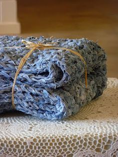 Denim rag rug - made from old jeans; just single crochet back and forth for the main part and one row of double crochet around the edge. Cut the denim into a long strip about 1 cm wide and use an 8 mm crochet hook. this rug is approx 1 meter by half a meter in size and took 4-5 pairs of jeans.