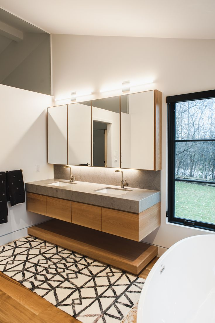 Gorgeous Modern Floating Vanity.  Warm wood with stone.