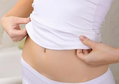 Get a Flat Belly by Friday -- 9 Ways to Slim Your Middle and Reduce Bloat in Under a Week