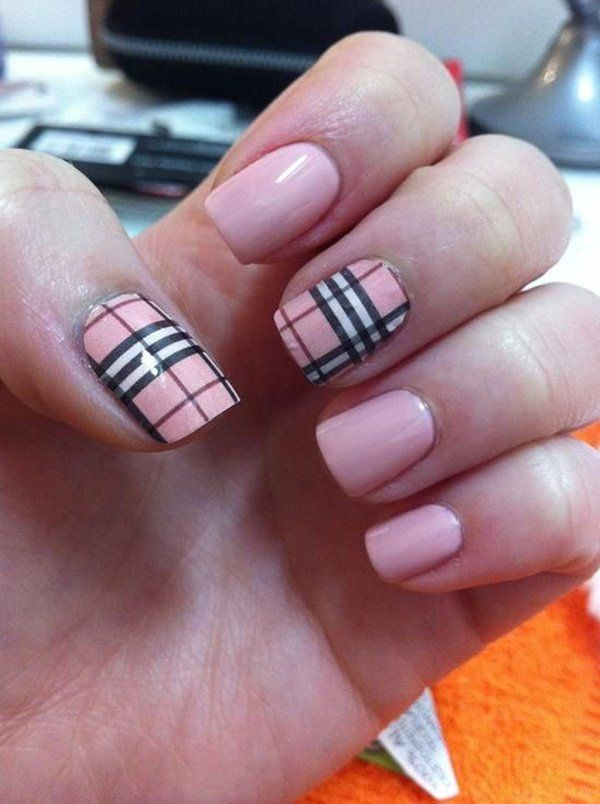 Check out this rather modest and cute looking plaid nail art design. The nails are coated with baby pink matte colors as well as using black and white polish as the thin and thick strips on top.