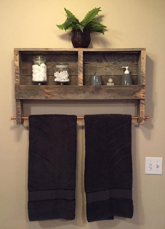 Display bathroom decor beautifully with this handmade shelf with a copper rod for hanging towels. Made from durable hardwood that is hand