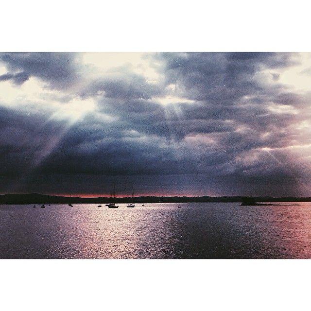 """This evening's rare sun rays finding the yachts of the Waitemata. #sun #sunrays #evening #sunset #twilight #water #VSCOcam #vsco #vsconature #vscofeature #visualsoflife #traveltheworld #bestofvsco #bestintravel #newzealand #neverstopexploring"" Photo taken by @sophie_hamer on Instagram, pinned via the InstaPin iOS App! http://www.instapinapp.com (02/12/2015)"