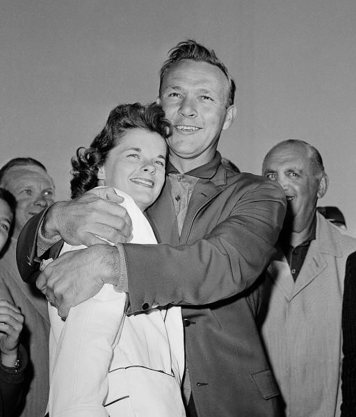 Arnold Palmer has a big hug for his wife, Winnie, after winning the Masters Golf Tournament