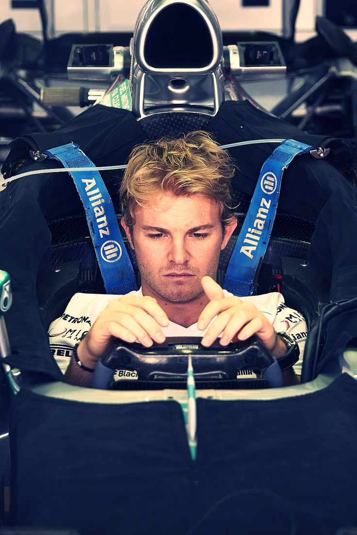 The one with the fabulous hair - Nico Rosberg. Saw this guy in person at Singapore :D too bad he didnt get to race though. Was really looking forward to seeing him drive!