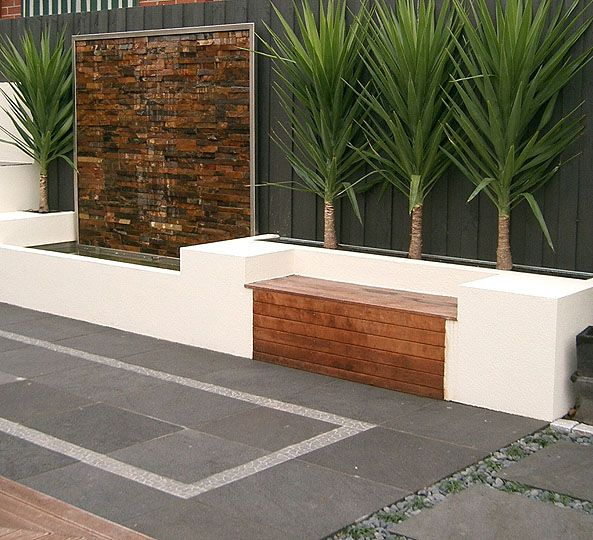 clean Bench seat along fence - water feature!