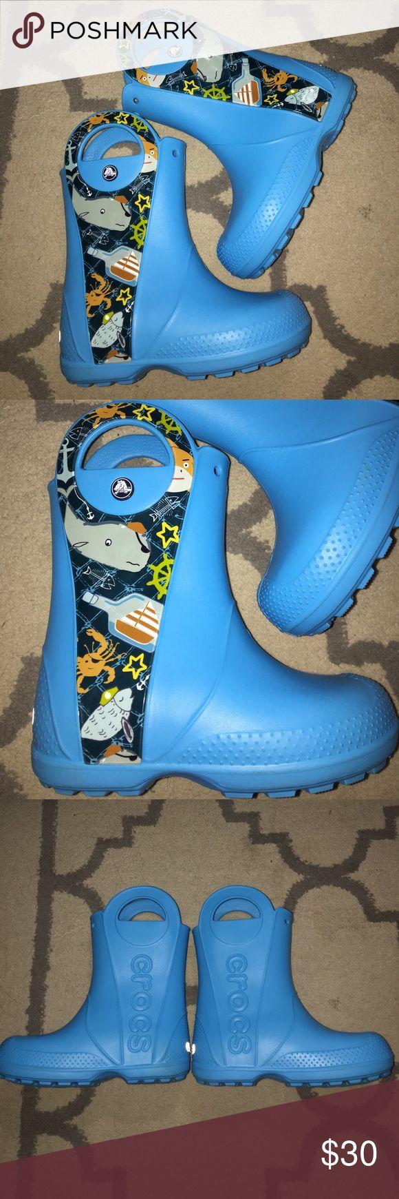 NWOT Handle It Sea life Sz 13 Crocs Rain Boots Super cute NWOT CROCS Toddler rain boots - Sz 13, the color is blue with nautical picture on side of both boot! CROCS Shoes Rain & Snow Boots