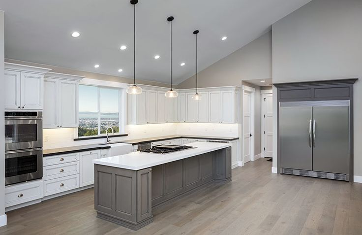 gray-and-white-kitchen-with-large-island-pendant-lights-and-vaulted-ceiling