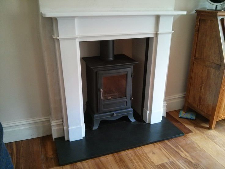 Chesneys Beaumont 6 fitted on a riven slate hearth with a Chesneys Devonshire marble surround.