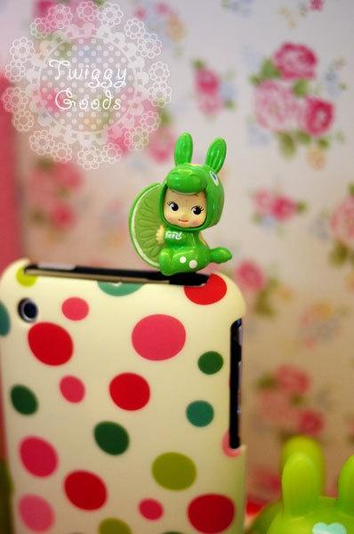 Green Rody Kewpie with Lemon Cellphone Dust Plug. Smart Phone Dust Plug Earphone Plug. $5.99, via Etsy.