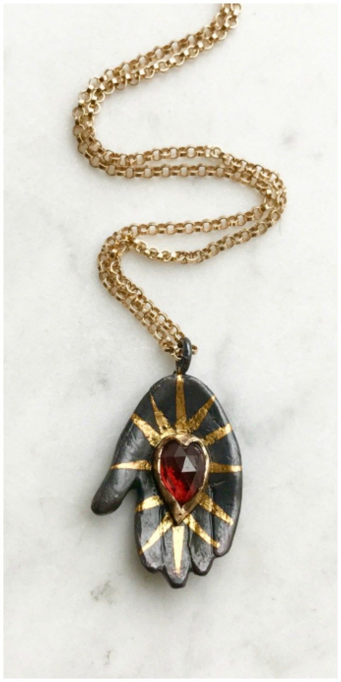 The beautiful hand and heart pendant by Acanthus jewelry.