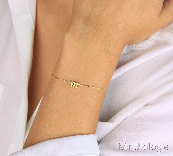 Dainty cursive initial on a beautiful diamond cut chain bracelet. Choose from gold, silver, or rose gold. Its great worn on its own or layered