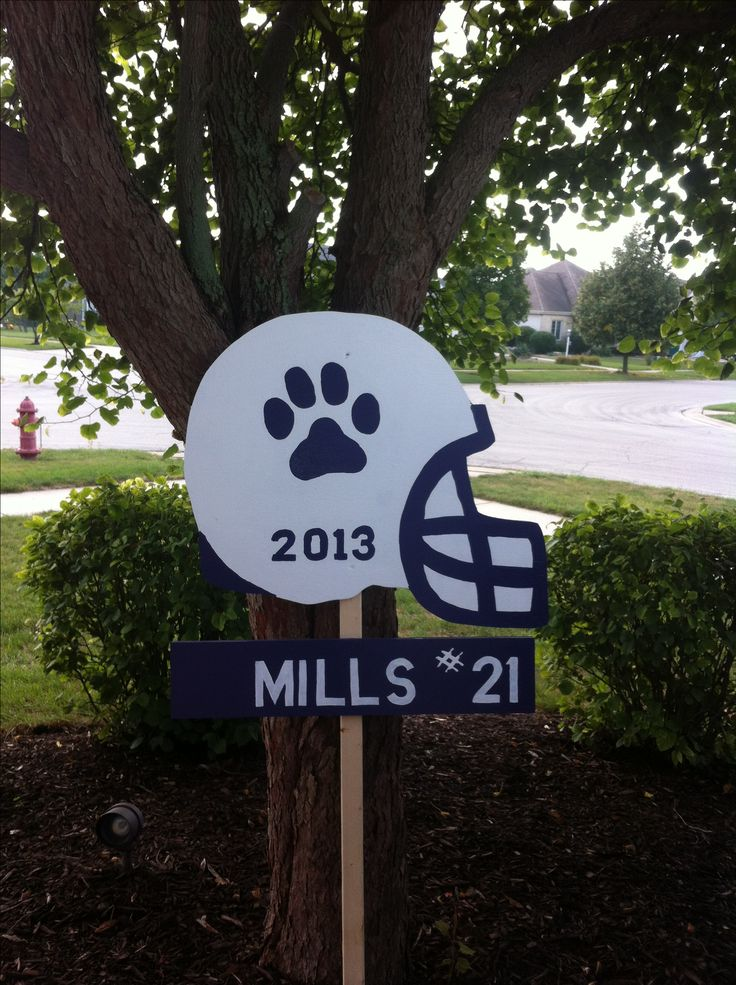 Homemade football yard sign by, Tina, Lisa and Tina. Senior moms rule!