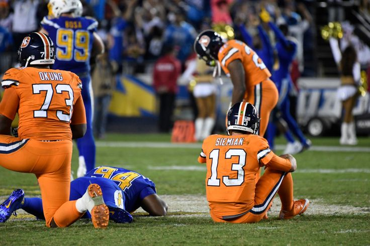 Broncos vs. Chargers:   October 13, 2016  -  21-13, Chargers   -      Denver Broncos quarterback Trevor Siemian (13) sits dejected after his last throw to the end zone with 8 second left in the fourth quarter October 13, 2016 at Qualcomm Stadium. The Broncos lose to the Chargers 21-13.