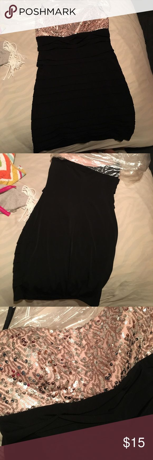 Slip on dress! Formal slip on dress! Worn once to homecoming dance! Black with pink chest and rose gold sequins! Ruby Rox Dresses Strapless