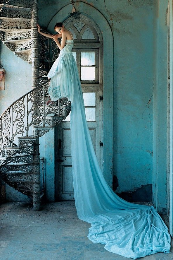Gorgeous picture.  Beautiful winding staircase and arched top window!