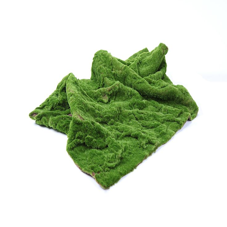 Artificial turf made to look like moss.  Cut this into organic shapes and place under pine trees for the look and feel of a forested tundra.