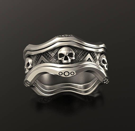 A one of a kind Sci-fi alien skull ring. Another similar design can be found here: https://www.etsy.com/il-en/listing/483312012/star-wars-ring-geek-wedding-ring-alien materials: Oxidized sterling silver 925 Available in all ring sizes