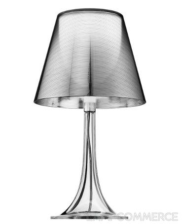 Flos- Miss K T table lamp: This unique modern table lamp provides slightly diffused lighting through two diffusers, one internal and one external, finished with a high vacuum aluminization process. With a transparent base only tinted with certain color options (black and red), this lamp can work well in any space, particularly an office or bedroom.