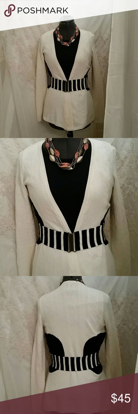 BEAUTIFUL MOTH ANTHRO SWEATER This beautiful belted cardigan is in excellent EUC worn maybe twice. Ivory color with black color blocker on the side ivory and black striped belt . Great addition to your wardrobe. Anthropologie Sweaters Cardigans