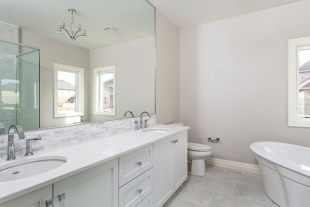 Beautiful White En-suite #bright #light #white #design #newhome #bathroom #caesarstone #quartz #soakertub