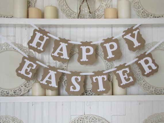 HAPPY EASTER Banner to welcome in the Spring! HAPPY EASTER is made with thick, strong, tan colored chipboard. White letters are affixed on top and white ribbon is strung through. #ad #affiliate #easter