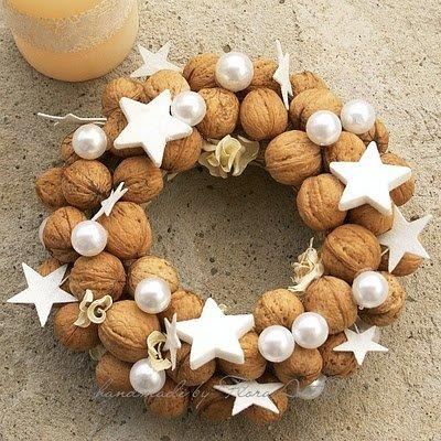 christmas wreath made of walnuts and white stars and moons
