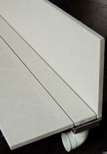 Ralo linear com acabamento do mesmo piso do banheiro