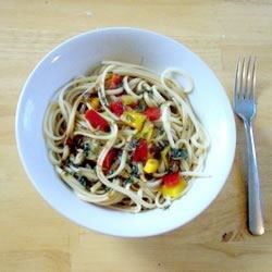 For an exotic, earthy flavor add sliced shiitake mushrooms and bell peppers to a pot of boiling capellini. Toss the warm noodles with a sauce of rice wine vinegar, soy, oil and grated ginger and sprinkle with parsley to serve.