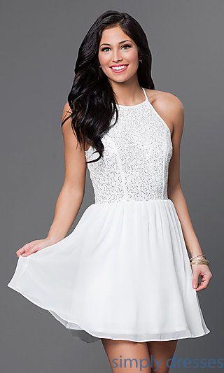 Shop short ivory-white graduation dresses and ivory cocktail dresses at Simply Dresses. Short ivory-white designer dresses with embellished tops.