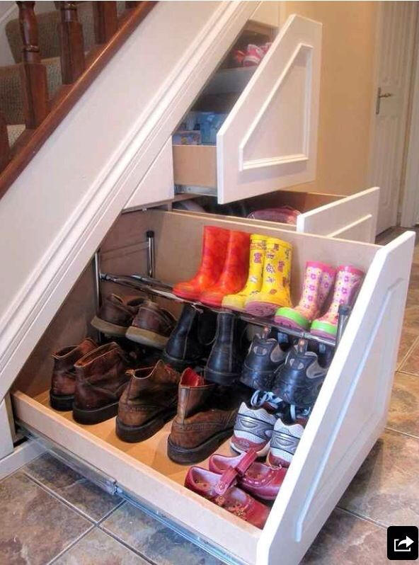 Mud room shoe storage--interesting. I wonder where they got the cabinets? Our area is right off garage, so this might be very practical.