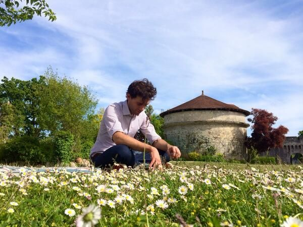 Mika taking a break from songwriting in a field May 2014