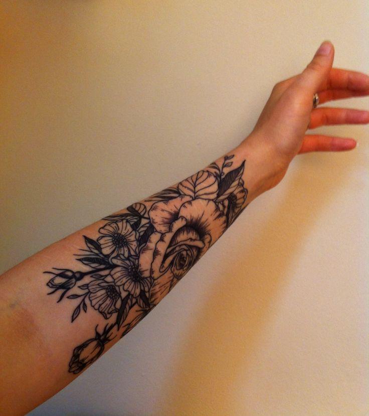 Vintage flowers tattoo, half sleeve, lots of line work.