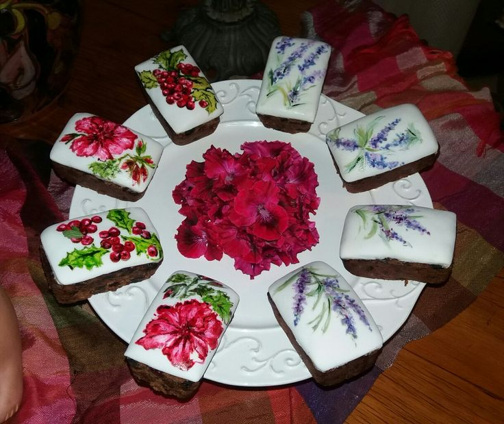 Dainty little Cristmas Fruit cakes hand-painted with berries, geraniums and lavender.