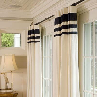 Wide bands of fabric at the headings of these draperies turn ready-made into a bolder statement. Get this look for your home by purchasing inexpensive solid curtain panels and adding horizontal bands of fabric or ribbon in decreasing widths. Try strips in 1-, 2-, and 4- inch widths, evenly spaced. You'll achieve a custom look without the custom price tag.