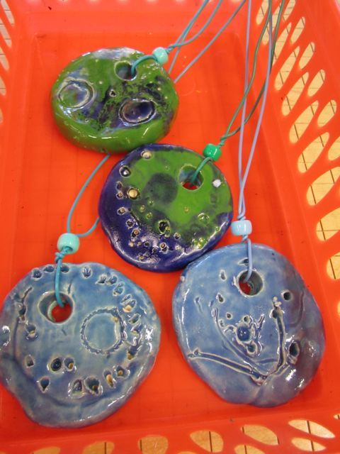 clay pendants - 1st grade Josette Brouwer. This would be an awesome Mother's Day gift!