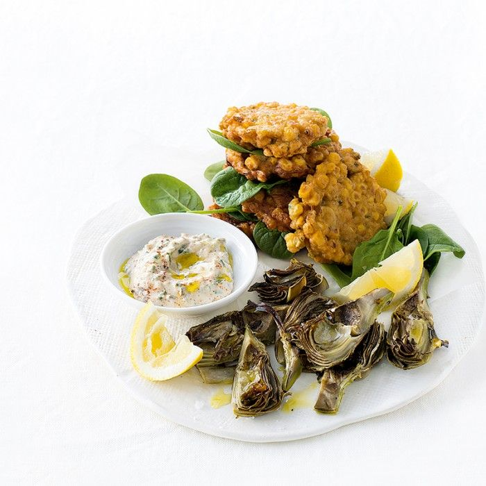 Warm weather weekends call for delicious finger food, like these corn fritters served with roasted artichokes and a tasty creamy dressing.