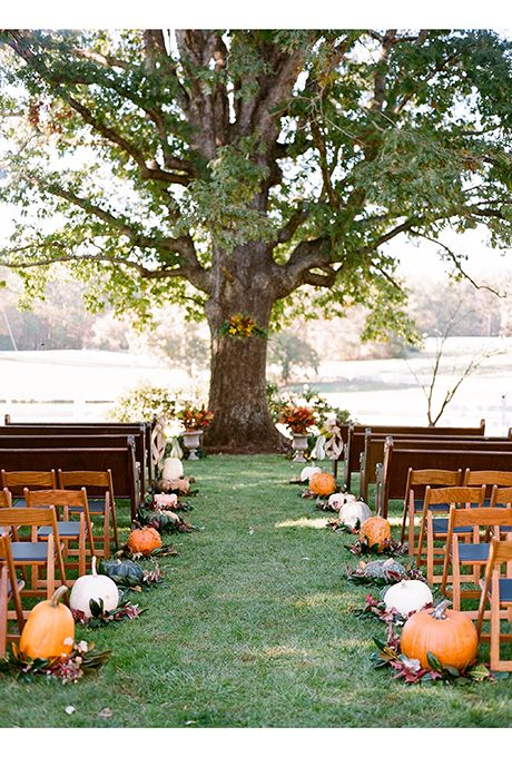 Brides.com: These pumpkins serve as decadent aisle markers, alternating in colors to really pop.