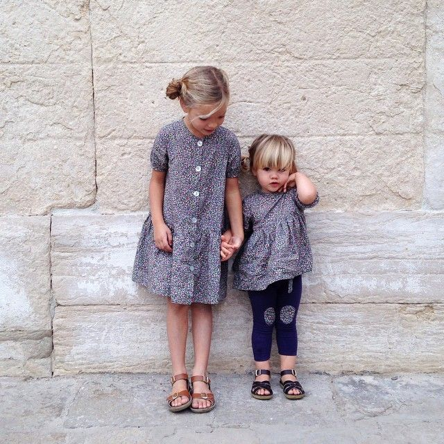 Sisters in matching outfits.
