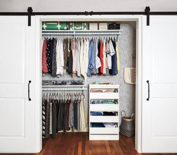 Organized closet with barn doors | Too much stuff, too little space, too many wardrobe woes. Perhaps you can relate? Real Simple helped a busy working mom transform her clothes closet, from what's in it to where it all goes. This two-part solution will work wonders for yours, too.