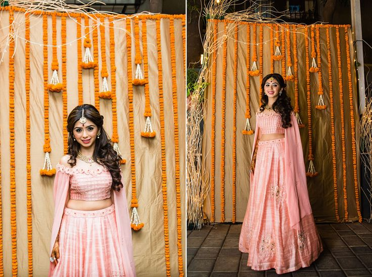 A pink off-shoulder blouse with a voluminous lehenga for Bride Dipti by Nisha Sainani