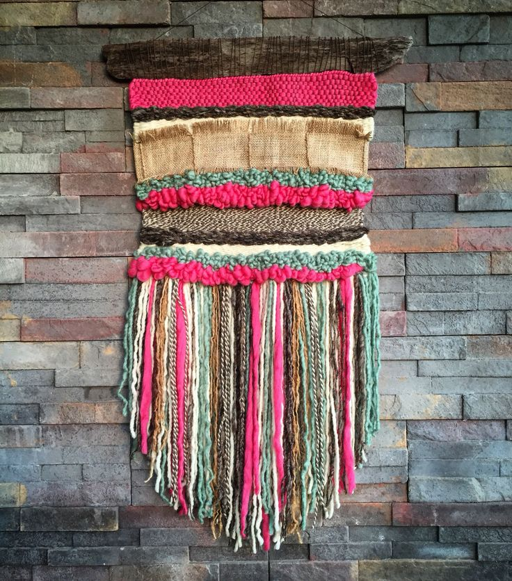 Woven wall hanging by Telares y Flecos