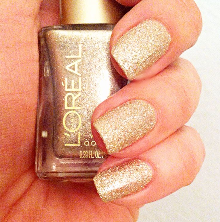 "Gold Glitter Nail Polish by Loreal #138 called ""The Statement Piece"""