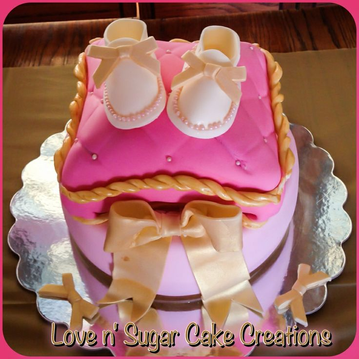 pink and gold pillow baby shower cake booties and bow made with