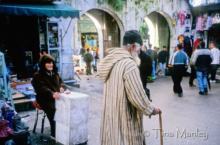 AFRICA; MOROCCO; TANGIER:  Market in old Tangier with people in traditional dress and man selling one pack of Marlboro cigarettes.